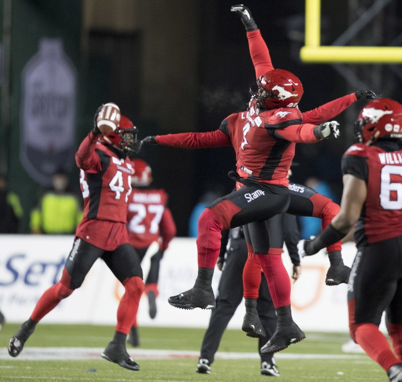 The Calgary Stampeders celebrate a fumble recovery against the Ottawa Redblacks during the second half of the Canadian Football League Grey Cup in Edmonton, Alberta, Sunday, Nov. 25, 2018. (Darryl Dyck/The Canadian Press via AP)