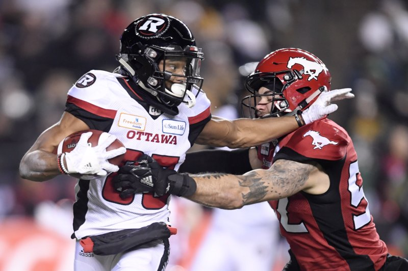 Ottawa Redblacks wide receiver Diontae Spencer (85) runs with the ball as Calgary Stampeders linebacker Riley Jones (52) tries to catch him during the second half of the 106th Grey Cup at Commonwealth Stadium in Edmonton, Alberta, Sunday, Nov. 25, 2018. (Nathan Denette/The Canadian Press via AP)