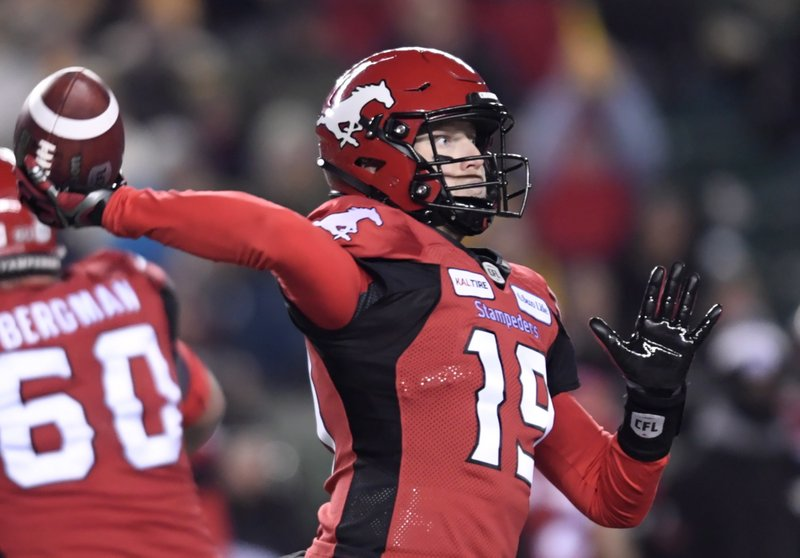 Calgary Stampeders quarterback Bo Levi Mitchell (19) prepares to throw the ball during the first half of the 106th Grey Cup against the Ottawa Redblacks in Edmonton, Alberta, Sunday, Nov. 25, 2018. (Nathan Denette/The Canadian Press via AP)