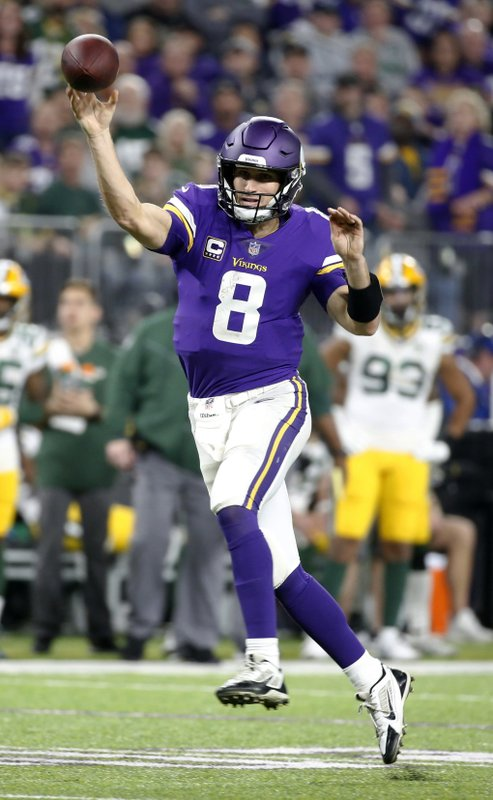 Minnesota Vikings quarterback Kirk Cousins throws a 14-yard touchdown pass to wide receiver Adam Thielen during the second half of the team's NFL football game against the Green Bay Packers, Sunday, Nov. 25, 2018, in Minneapolis. (AP Photo/Bruce Kluckhohn)
