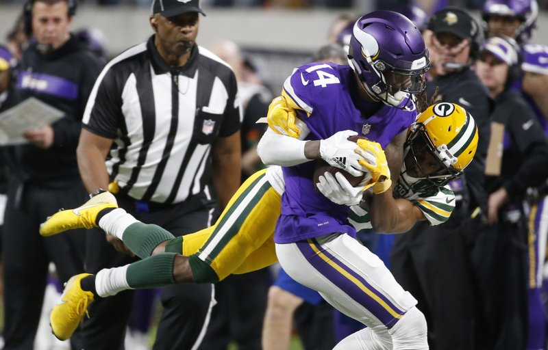 Minnesota Vikings wide receiver Stefon Diggs is forced out of bounds by Green Bay Packers cornerback Tramon Williams, rear, after making a reception during the second half of an NFL football game Sunday, Nov. 25, 2018, in Minneapolis. (AP Photo/Bruce Kluckhohn)