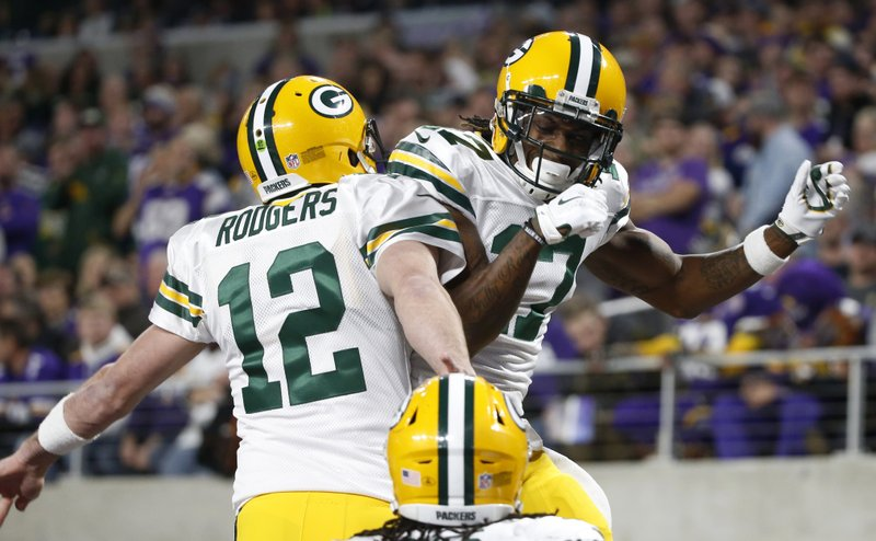 Green Bay Packers wide receiver Davante Adams (17) celebrates with Aaron Rodgers (12) after catching a 15-yard touchdown pass during the first half of an NFL football game against the Minnesota Vikings, Sunday, Nov. 25, 2018, in Minneapolis. (AP Photo/Bruce Kluckhohn)