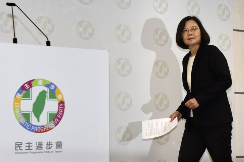 In this Nov. 24, 2018, photo, Taiwanese President Tsai Ing-wen arrives for a press conference, after local elections at the headquarters of Democratic Progressive Party, in Taipei. A strong showing by Taiwan's opposition Nationalist Party in this weekend's local elections presents a major challenge to independence-leaning President Tsai as she grapples with growing economic, political and military pressure from rival China. (Kyodo News via AP)