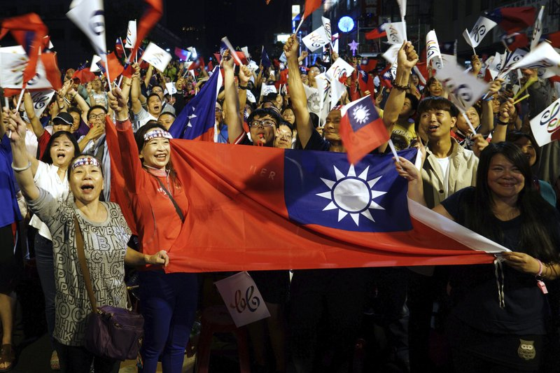 FILE - In this Nov. 24, 2018, file photo, supporters of the opposition Nationalist Party cheer in Kaohsiung, Taiwan. A strong showing by Taiwan's opposition Nationalist Party in this weekend's local elections presents a major challenge to independence-leaning President Tsai as she grapples with growing economic, political and military pressure from rival China. (AP Photo/File)