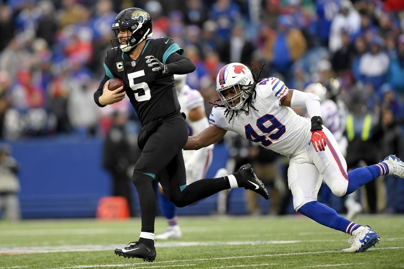Buffalo Bills middle linebacker Tremaine Edmunds (49) moves in to tackle Jacksonville Jaguars quarterback Blake Bortles (5) during the second half of an NFL football game, Sunday, Nov. 25, 2018, in Orchard Park, N.Y. (AP Photo/Adrian Kraus)