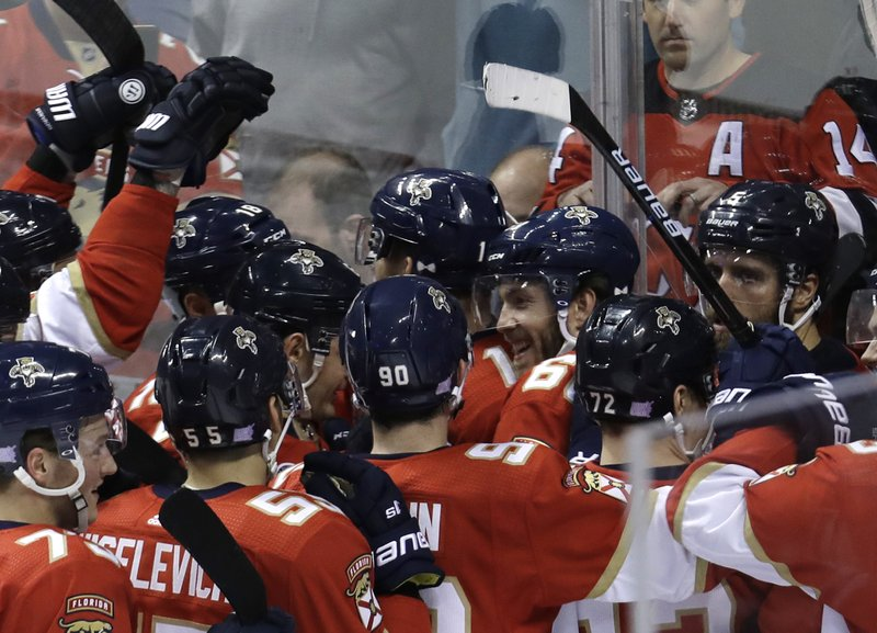 Florida Panthers left wing Mike Hoffman (68) is congratulated after scoring the winning goal during overtime of an NHL hockey game against the New Jersey Devils, Monday, Nov. 26, 2018, in Sunrise, Fla. (AP Photo/Lynne Sladky)