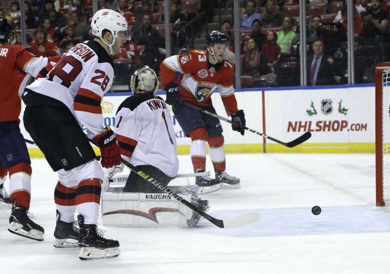 The puck goes past New Jersey Devils goaltender Keith Kinkaid (1) on a goal scored by Florida Panthers center Jared McCann during the second period of an NHL hockey game, Monday, Nov. 26, 2018, in Sunrise, Fla. (AP Photo/Lynne Sladky)