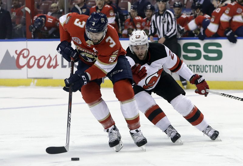 Florida Panthers defenseman Keith Yandle (3) skates with the puck as New Jersey Devils right wing Stefan Noesen defends during the first period of an NHL hockey game, Monday, Nov. 26, 2018, in Sunrise, Fla. (AP Photo/Lynne Sladky)