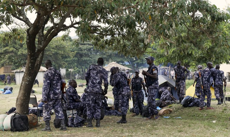 FILE - In this Monday, Nov. 28, 2016 file photo, members of the Uganda People's Defence Force gather in the town of Kasese, Uganda. On Nov. 27, 2018 the United States are urging that Ugandan authorities fully investigate a military attack on a tribal king's palace two years ago that killed over 100 civilians. (AP Photo/Arne Gillis, File)