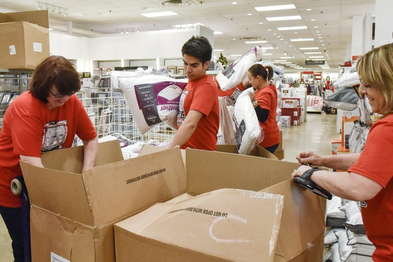 JCPenney employees restock home goods on Black Friday at Broadway Square Mall in Tyler, Texas, on Friday, Nov. 23, 2018. (Chelsea Purgahn/Tyler Morning Telegraph via AP)