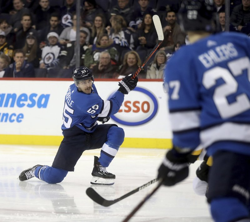 Winnipeg Jets' Mark Scheifele (55) scores against the Pittsburgh Penguins during the second period of an NHL hockey game, Tuesday, Nov. 27, 2018, in Winnipeg, Manitoba. (Trevor Hagan/The Canadian Press via AP)