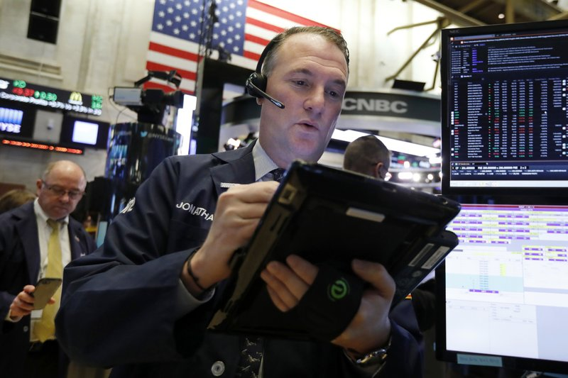 Trader Jonathan Corpina works on the floor of the New York Stock Exchange, Wednesday, Nov. 28, 2018. Stocks are opening higher on Wall Street, led by solid gains in big technology and health care companies. (AP Photo/Richard Drew)