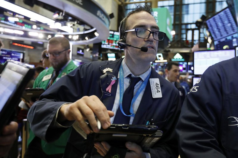 Trader Gregory Rowe works on the floor of the New York Stock Exchange, Wednesday, Nov. 28, 2018. Stocks are opening higher on Wall Street, led by solid gains in big technology and health care companies. (AP Photo/Richard Drew)