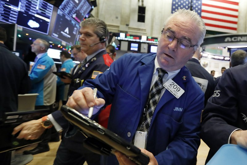 Trader James Dresch, right, works on the floor of the New York Stock Exchange, Wednesday, Nov. 28, 2018. Stocks are opening higher on Wall Street, led by solid gains in big technology and health care companies. (AP Photo/Richard Drew)