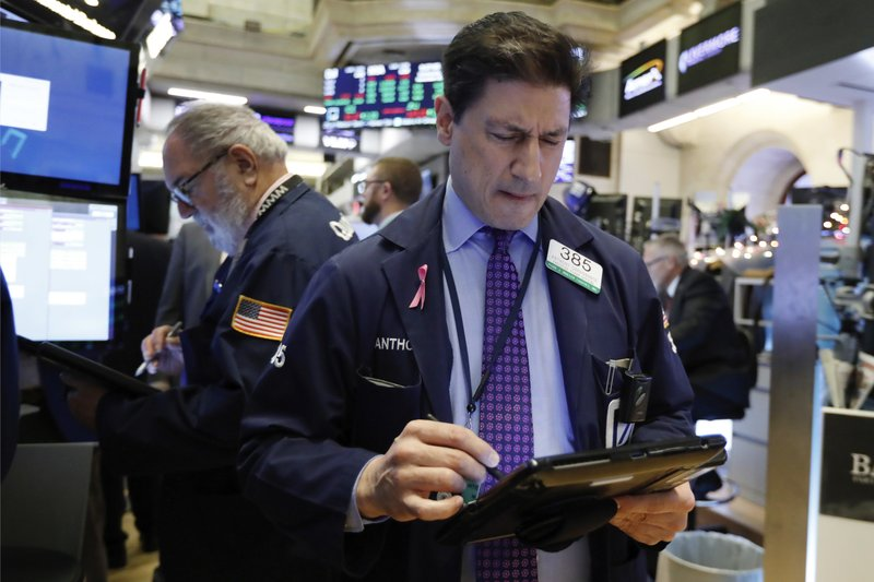 Trader Anthony Carannante, right, works on the floor of the New York Stock Exchange, Wednesday, Nov. 28, 2018. Stocks are opening higher on Wall Street, led by solid gains in big technology and health care companies. (AP Photo/Richard Drew)