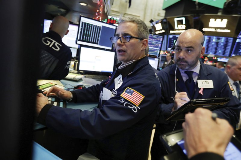 Specialist Anthony Rinaldi, left, and trader Fred DeMarco work on the floor of the New York Stock Exchange, Wednesday, Nov. 28, 2018. Stocks are opening higher on Wall Street, led by solid gains in big technology and health care companies. (AP Photo/Richard Drew)