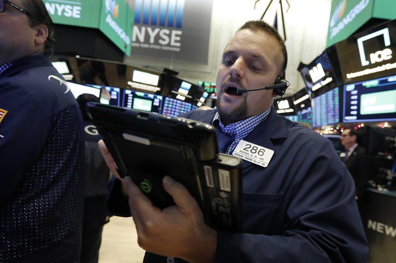 Trader Michael Milano works on the floor of the New York Stock Exchange, Wednesday, Nov. 28, 2018. Stocks are opening higher on Wall Street, led by solid gains in big technology and health care companies. (AP Photo/Richard Drew)