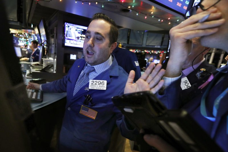 Specialist Gennaro Sapolito works at his post on the floor of the New York Stock Exchange, Wednesday, Nov. 28, 2018. Stocks are opening higher on Wall Street, led by solid gains in big technology and health care companies. (AP Photo/Richard Drew)