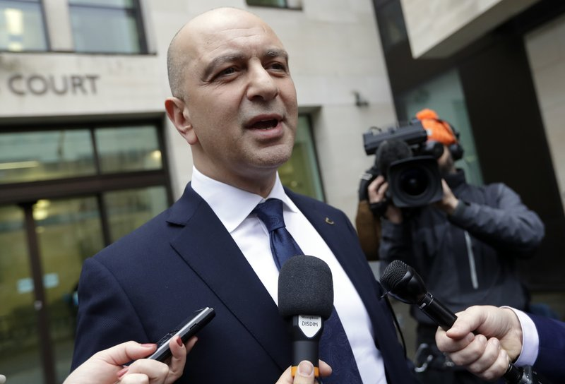 Akin Ipek speaks to media as he leaves Westminster Magistrates Court after his extradition hearing was dismissed in London, Wednesday, Nov. 28, 2018. Akin Ipek, is a high-profile critic of President Erdogan of Turkey whose newspapers and TV stations were seized by the Turkish state in 2015. The Turkish Government was seeking the extradition of Mr Ipek, who lives in London and is the director of British company Koza Ltd, and other critics of the Erdogan regime. (AP Photo/Kirsty Wigglesworth)