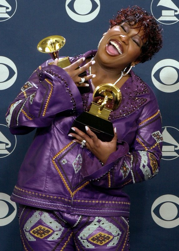 FILE - In this Feb. 27, 2002 file photo, Missy Elliott holds the Grammys she won for best rap solo performance and best pop collaboration with vocals at the 44th annual Grammy Awards in Los Angeles. Elliott, one of rap's greatest voices and also a songwriter and producer who has crafted songs for Beyonce and Whitney Houston, is one of the nominees for the 2019 Songwriters Hall of Fame. (AP Photo/Reed Saxon, File)
