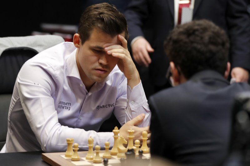 Reigning chess world champion, Norway's Magnus Carlsen, left, and Italian-American Fabiano Caruana concentrate at the final day of the World chess Championship in London, Wednesday, Nov. 28, 2018.(AP Photo/Frank Augstein)