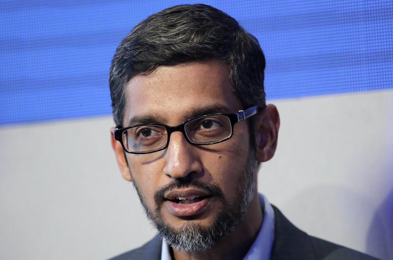 FILE- In this Jan. 24, 2018, file photo Sundar Pichai, CEO of Google, speaks during a conversation as part of the annual meeting of the World Economic Forum in Davos, Switzerland. Pichai will testify next week at a congressional hearing on the company's business practices, just three months after aides put up an empty chair to symbolize his refusal to appear. Pichai's scheduled Dec. 5 appearance before the House Judiciary Committee comes after he traveled to Washington in late September to meet privately with lawmakers peeved by his refusal to appear. (AP Photo/Markus Schreiber, File)