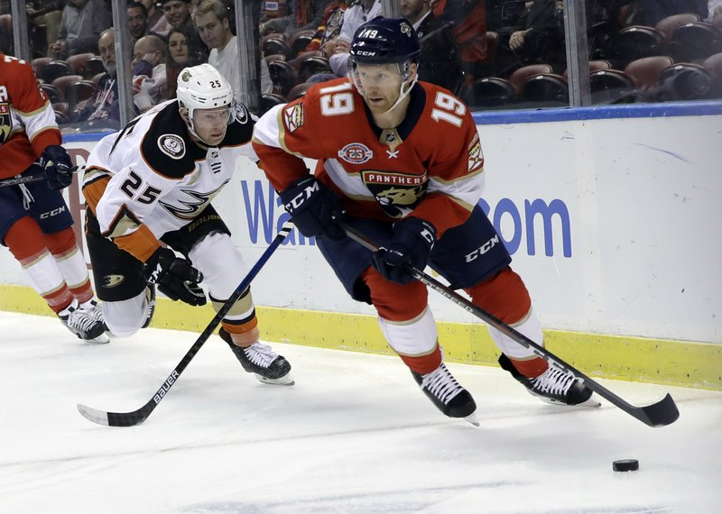 Florida Panthers defenseman Mike Matheson (19) skates with the puck as Anaheim Ducks right wing Ondrej Kase (25) pursues during the first period of an NHL hockey game, Wednesday, Nov. 28, 2018, in Sunrise, Fla. (AP Photo/Lynne Sladky)