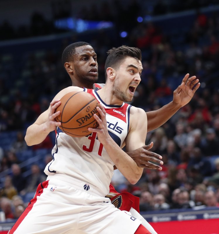 Washington Wizards guard Tomas Satoransky (31) goes to the basket in front of New Orleans Pelicans forward Darius Miller in the first half of an NBA basketball game in New Orleans, Wednesday, Nov. 28, 2018. (AP Photo/Gerald Herbert)