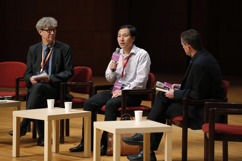 He Jiankui, a Chinese researcher, center, speaks during the Human Genome Editing Conference in Hong Kong, Wednesday, Nov. 28, 2018. He made his first public comments about his claim to have helped make the world's first gene-edited babies. (AP Photo/Kin Cheung)