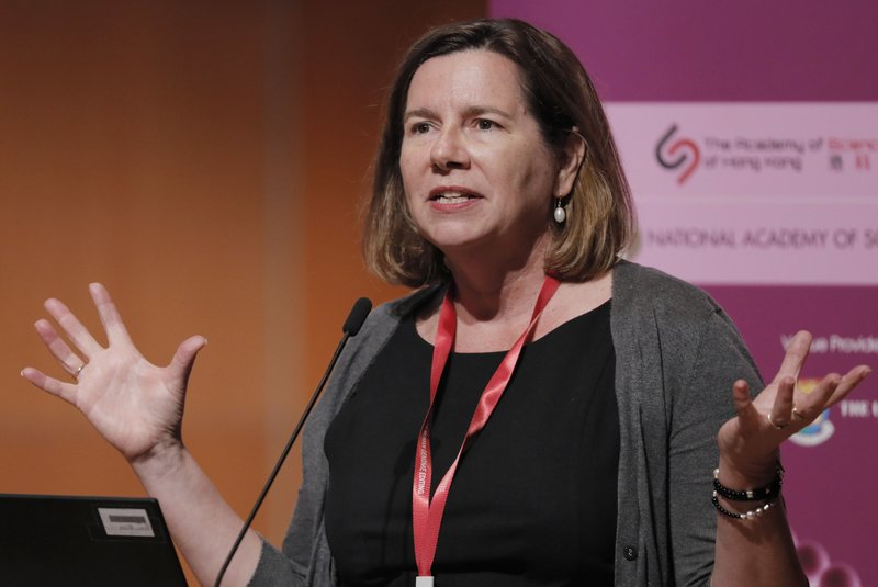 Megan Munsie of University of Melbourne speaks during the Human Genome Editing Conference in Hong Kong, Thursday, Nov. 29, 2018. (AP Photo/Vincent Yu)