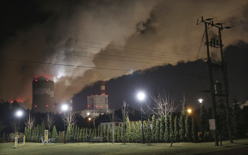 Clouds of smoke over Europe's largest lignite power plant in Belchatow, central Poland, on Wednesday, Nov. 28, 2018. A group of Greenpeace environment activists have climbed its 180-meter smokestack to spur participants in next week's global climate summit in Poland into taking decisions on limiting the use of coal.(AP Photo/Czarek Sokolowski)