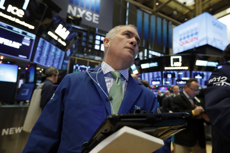 Trader Timothy Nick works on the floor of the New York Stock Exchange, Thursday, Nov. 29, 2018. U.S. stocks are lower Thursday morning after huge gains the day before. (AP Photo/Richard Drew)