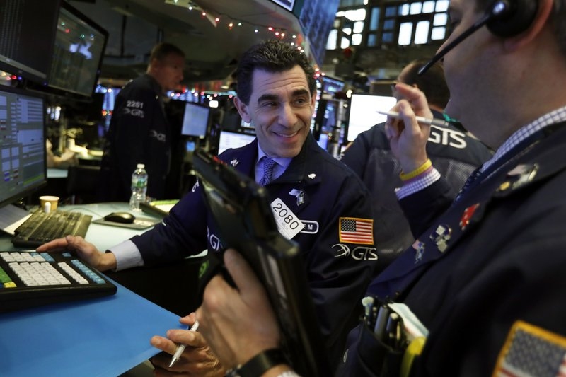 Specialist Peter Mazza, left, and trader John Panin work on the floor of the New York Stock Exchange, Thursday, Nov. 29, 2018. U.S. stocks are lower Thursday morning after huge gains the day before. (AP Photo/Richard Drew)
