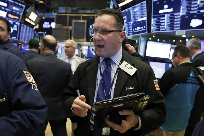 Trader Edward Curran works on the floor of the New York Stock Exchange, Thursday, Nov. 29, 2018. U.S. stocks are lower Thursday morning after huge gains the day before. (AP Photo/Richard Drew)