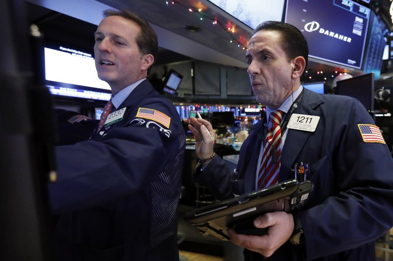 Specialist Glen Carrell, left, and trader Tommy Kalikas work on the floor of the New York Stock Exchange, Thursday, Nov. 29, 2018. U.S. stocks are lower Thursday morning after huge gains the day before. (AP Photo/Richard Drew)