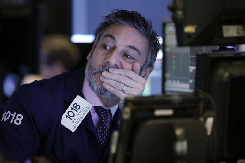 Trader John Romolo works on the floor of the New York Stock Exchange, Thursday, Nov. 29, 2018. U.S. stocks are lower Thursday morning after huge gains the day before. (AP Photo/Richard Drew)