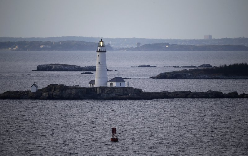 FILE- In this Aug. 25, 2016 file photo, Boston Light flashes in outer Boston Harbor. A canary in a coal mine? How about a flounder in a harbor? Offering a rare bit of good environmental news, scientists have documented a dramatic rebound in fish health they say shows how once horribly polluted Boston Harbor has cleaned up its act. (AP Photo/Elise Amendola, File)