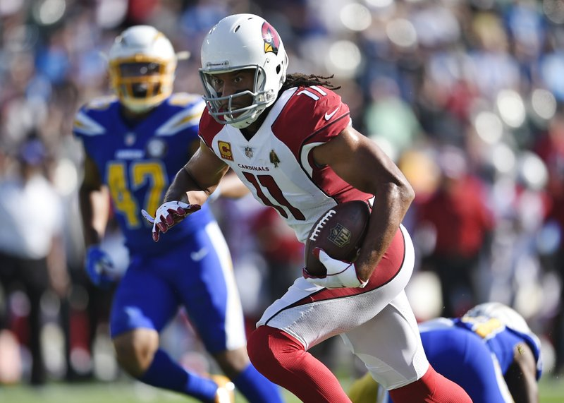 FILE - In this Nov. 25, 2018, file photo, Arizona Cardinals' Larry Fitzgerald (11) runs for a touchdown against the Los Angeles Chargers during the first half of an NFL football game in Carson, Calif. The veteran receiver with 1,278 career catches needs four to pass Hall of Famer Jerry Rice (1,281 with 49ers) for most receptions in NFL history with one team. (AP Photo/Kelvin Kuo, File)