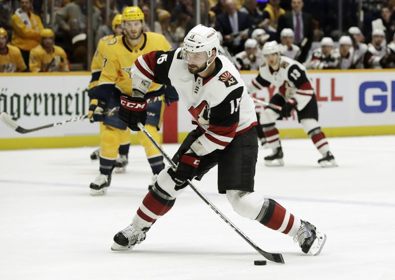Arizona Coyotes center Brad Richardson (15) shoots against the Nashville Predators during the first period of an NHL hockey game Thursday, Nov. 29, 2018, in Nashville, Tenn. (AP Photo/Mark Humphrey)