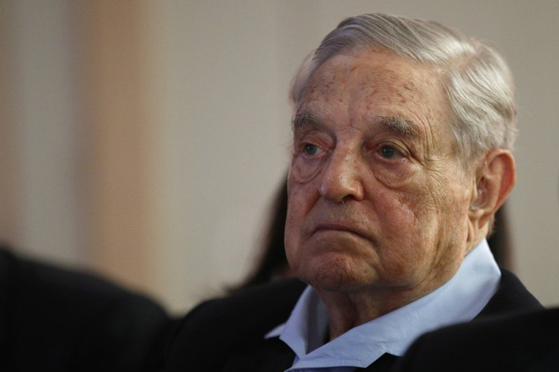 FILE- In this May 29, 2018, file photo George Soros, Founder and Chairman of the Open Society Foundations listens to the conference after his speech entitled