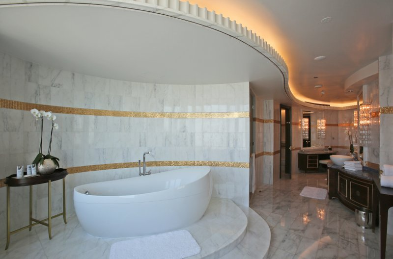 FILE- This May 19, 2014, file photo shows the master bathroom in the Abu Dhabi Suite at the St. Regis in Abu Dhabi, United Arab Emirates. The information of as many as 500 million guests at Starwood hotels has been compromised and Marriott said that it's discovered that unauthorized access to data within its Starwood network has been taking place since 2014. The company said Friday, Nov. 30, 2018, that credit card numbers and expiration dates of some guests may have been taken. (AP Photo/Kamran Jebreili, File)