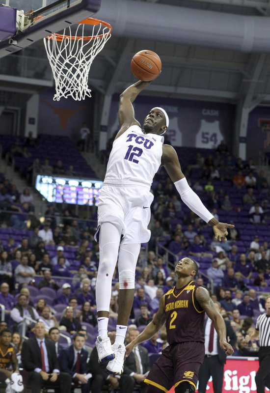 TCU forward Kouat Noi (12) goes up for a dunk against Central Michigan during the first half of an NCAA college basketball game Friday, Nov. 30, 2018, in Fort Worth, Texas. (AP Photo/Richard W. Rodriguez)
