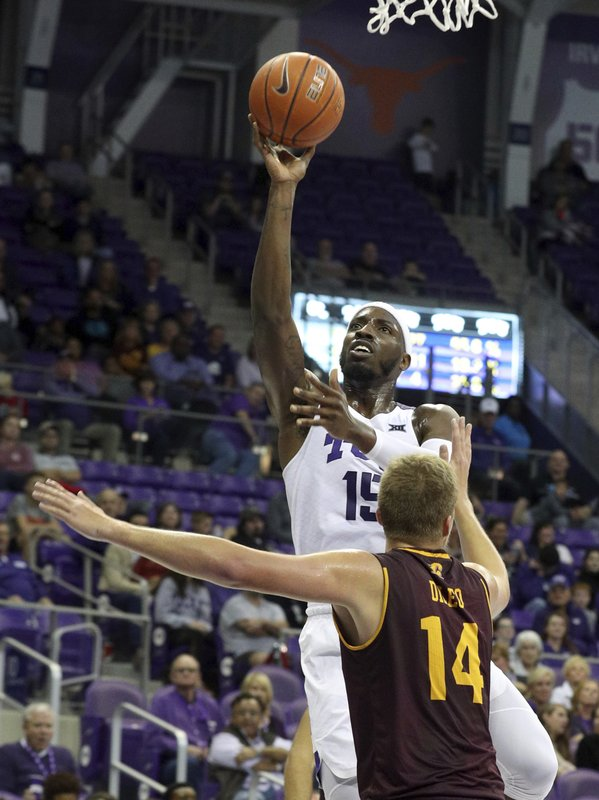 TCU forward JD Miller (15) shoots over Central Michigan forward David DiLeo (14) during the first half of an NCAA college basketball game Friday, Nov. 30, 2018, in Fort Worth, Texas. (AP Photo/Richard W. Rodriguez)