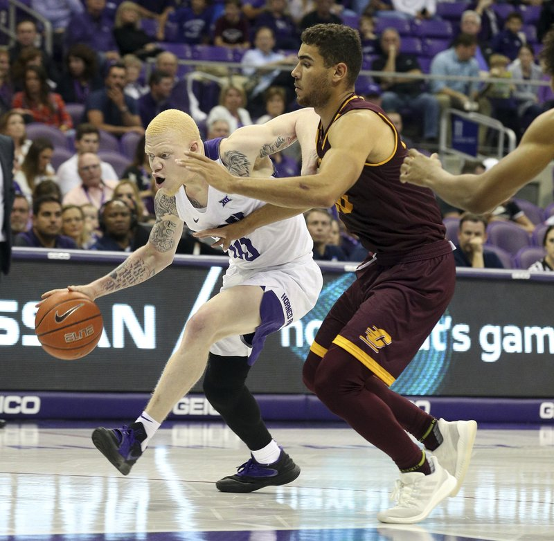 TCU guard Jaylen Fisher (10) tries to drive past Central Michigan guard Kevin McKay (20) during the first half of an NCAA college basketball game Friday, Nov. 30, 2018, in Fort Worth, Texas. (AP Photo/Richard W. Rodriguez)