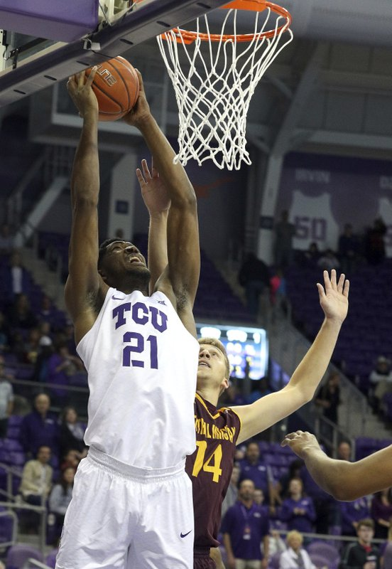 TCU center Kevin Samuel (21) goes up for the dunk over Central Michigan forward David DiLeo (14) during the first half of an NCAA college basketball game Friday, Nov. 30, 2018, in Fort Worth, Texas. (AP Photo/Richard W. Rodriguez)