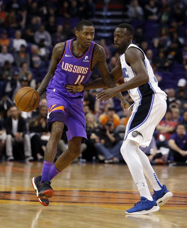 Phoenix Suns guard Jamal Crawford (11) drives on Orlando Magic guard Jerian Grant during the second half of an NBA basketball game Friday, Nov. 30, 2018, in Phoenix. The Magic defeated the Suns 99-85. (AP Photo/Rick Scuteri)