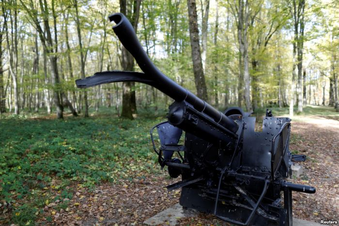 A damaged cannon is on display in the middle of Belleau Wood behind the Aisne