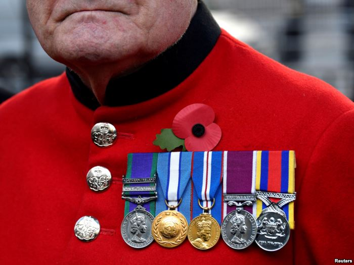 A veteran visits the Field of Remembrance at Westminster Abbey in London, Nov