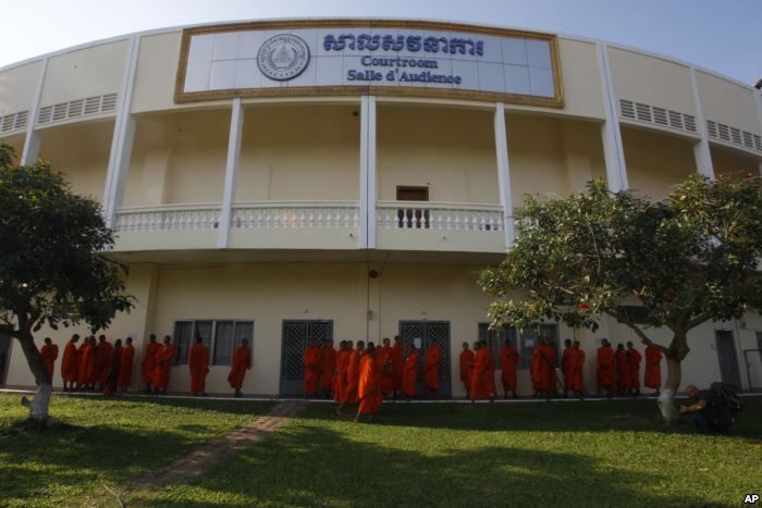 Cambodian Buddhist wait outside the court hall before they attending the hear