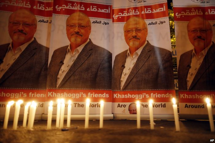 FILE - Candles, lit by activists protesting the killing of Saudi journalist J